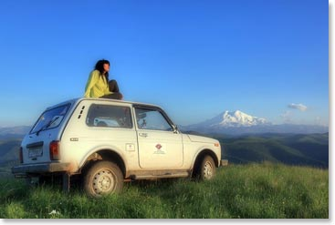 On a sunny summer day not far from Mount Elbrus, Karina sits on her trusty 4-wheel drive, which has been on many BAI adventures in the Caucasus Mountains.