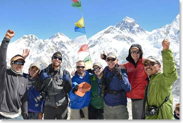 Team members on the summit of Kala Patar with Everest behind them.