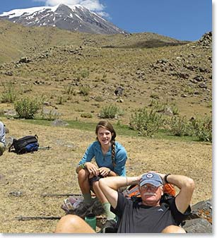 Granddaughter and grandfather team take a break while climbing Mount Ararat
