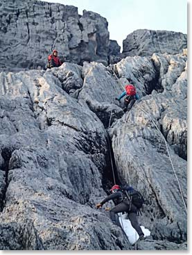 Climbing along fixed lines to the Summit of Carstensz Pyramid