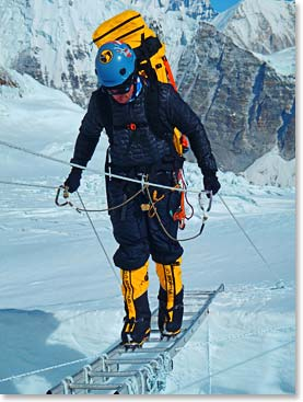 Daniel Branham crossing a ladder on Everest