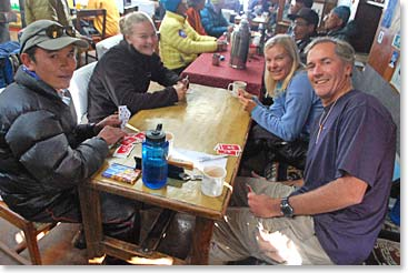 Playing cards is a favorite pastime of trekkers spending much of their time in the lodges
