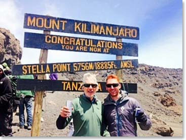 KINAPA even erected a new summit sign at Stella Point. Father and son Jonathan and Jordan Aibel stand proud in front of it