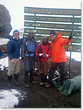 Danny and Hendrik with their guides Emmanuel and Samson on the top of Kilimanjaro