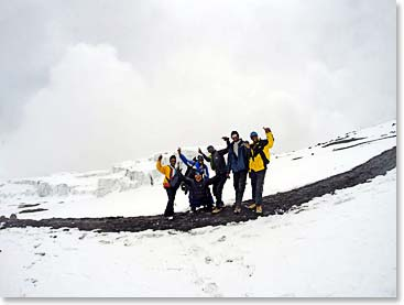 The team after reaching the summit, just as the snow is rolling in