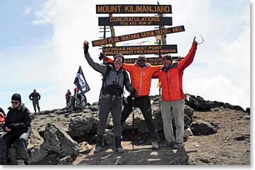 BAI climbers were some of the first to reach the summit and stand in front of the newly erected summit sign.