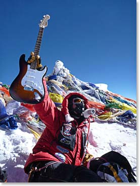 Todd Pendleton holds a signed Alice Cooper guitar on the Summit of Everest. He carried the guitar with him to raise money for the Leukemia and Lymphoma Society.