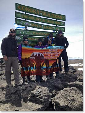 The Janmohamed family,  Josh Lannon and Jason Funk at Uhuru Peak, after dancing their way to the summit of Kilimanjaro!