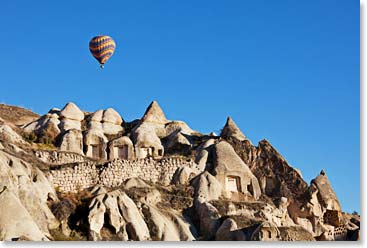 A balloon flies over Cappadocia