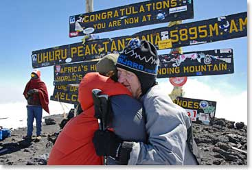 Emotional moment on the summit of kili with his daughter