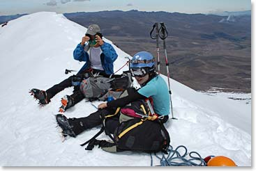 Climbers hydrating while enjoying the view from the summit of Chimborazo at 20,701ft/6,310m