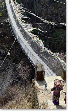 Crossing a suspension bridge between Namche and Phakding
