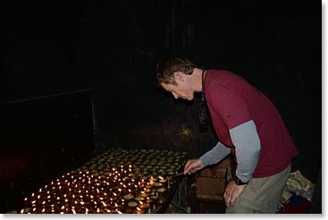 Climber lighting butter lamps in Kathmandu prior to his Everest climb