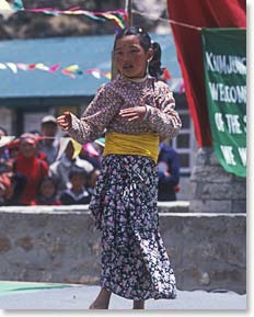 A Sherpa girl dances at a festival